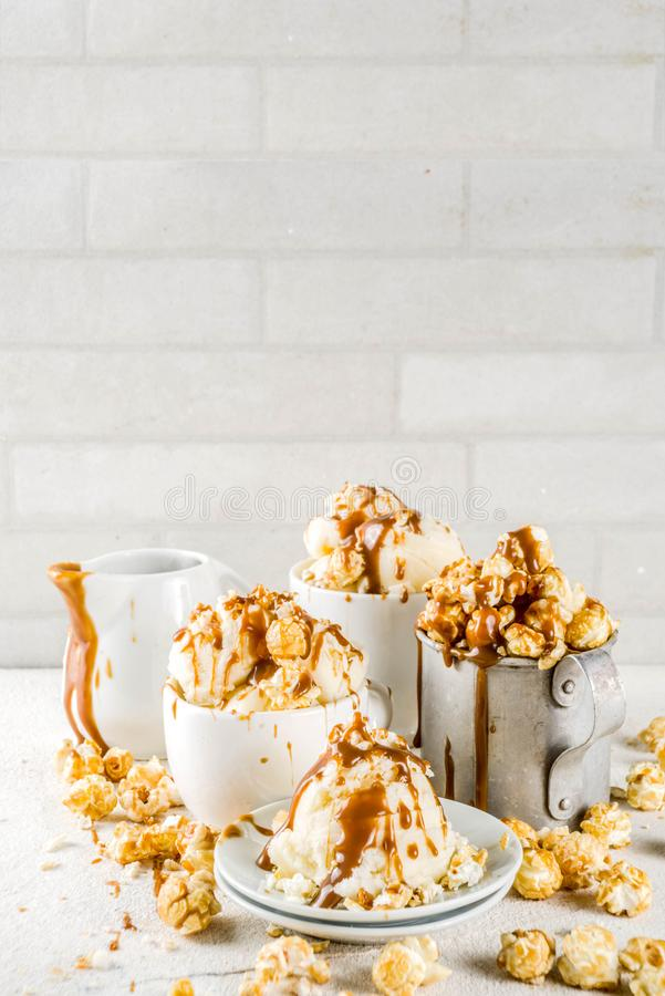 Caramel pop corn ice cream. Much of homemade caramel ad pop corn ice cream, on white marble ice cream copy space stock photography