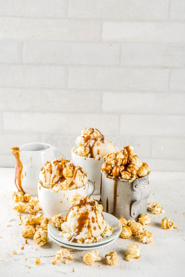 Caramel pop corn ice cream. Much of homemade caramel ad pop corn ice cream, on white marble ice cream copy space stock photos