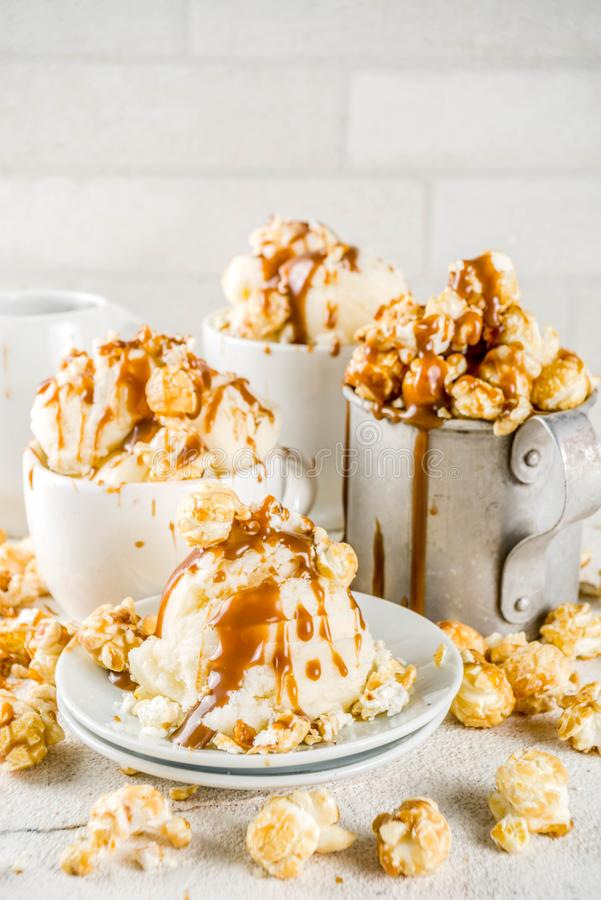 Caramel pop corn ice cream. Much of homemade caramel ad pop corn ice cream, on white marble ice cream copy space stock photo