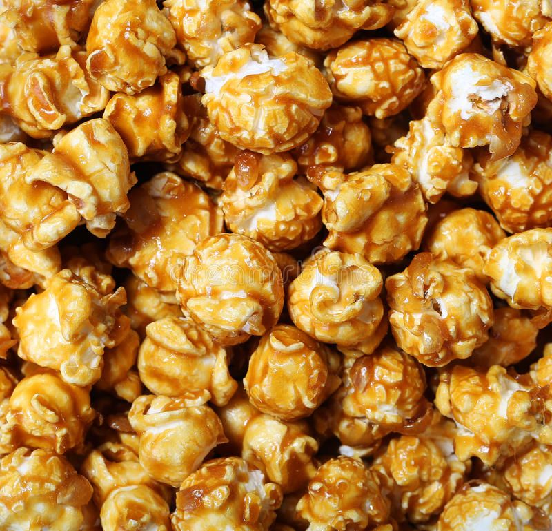 Caramel pop corn. Sweet caramel pop corn background royalty free stock photo