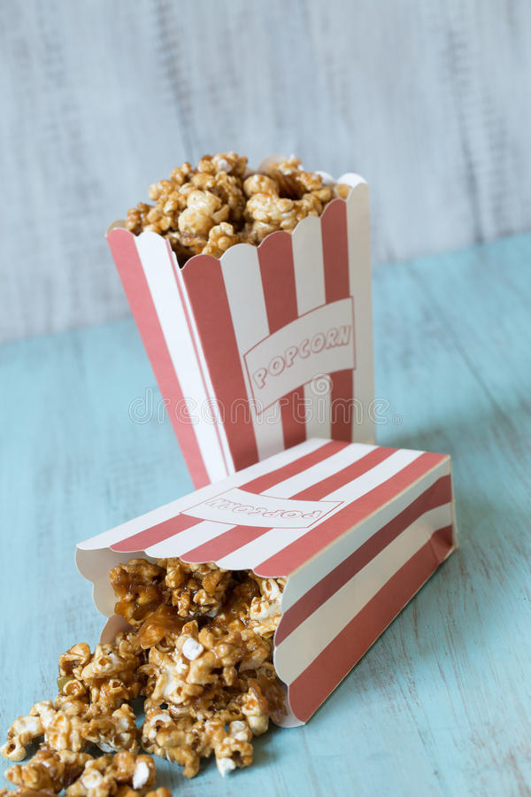 Caramel Popcorn Bags With One Spilling royalty free stock photo
