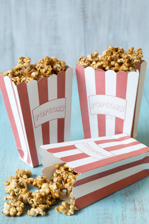Caramel Popcorn with One Spilling stock photos