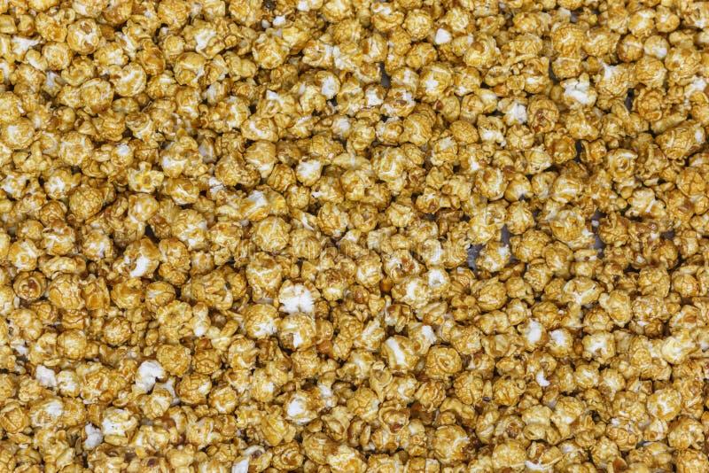Caramel popcorn texture background stock photography
