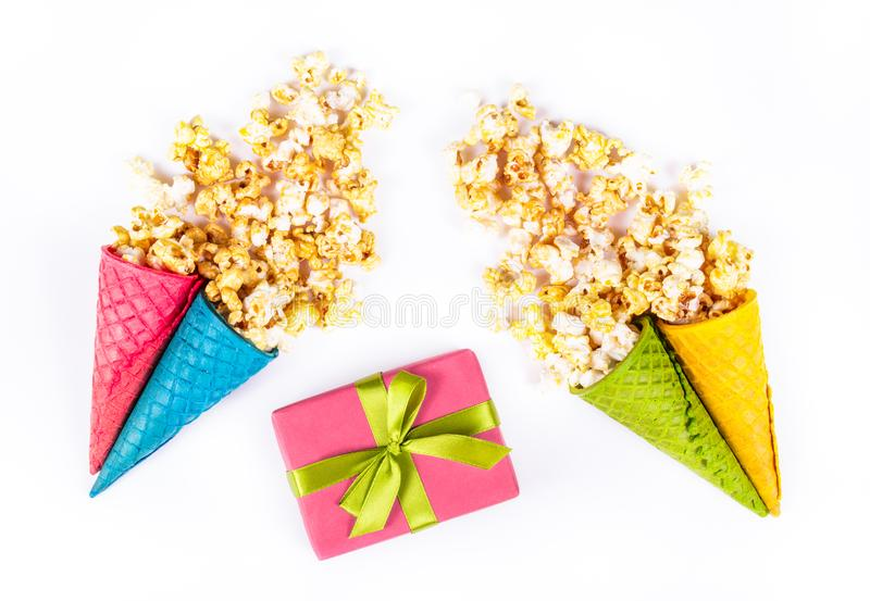 Caramel popcorn in waffle cup. Festive sweets, caramel popcorn, waffles and a gift box. stock image