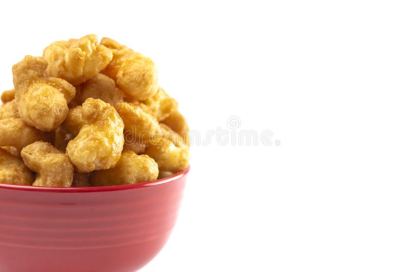 Caramel Puff Corn Popcorn on a White Background. Caramel Puff Corn Popcorn Isolated on a White Background royalty free stock images