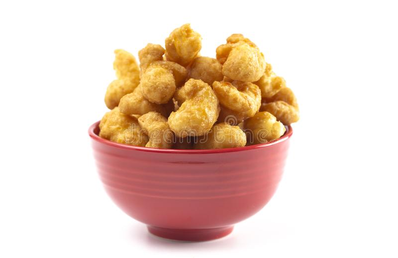 Caramel Puff Corn Popcorn on a White Background. Caramel Puff Corn Popcorn Isolated on a White Background royalty free stock image