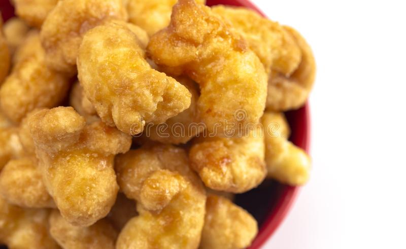 Caramel Puff Corn Popcorn on a White Background. Caramel Puff Corn Popcorn Isolated on a White Background stock photos