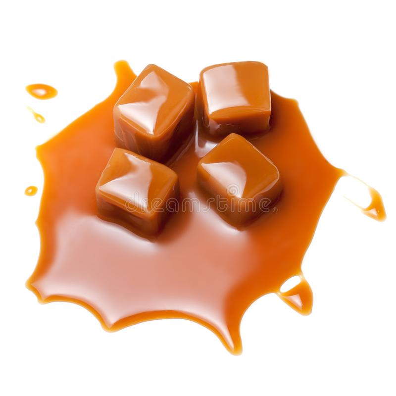 Caramel with sauce. Golden Butterscotch toffee candy caramels. S. Weets with copy space, macro royalty free stock photo