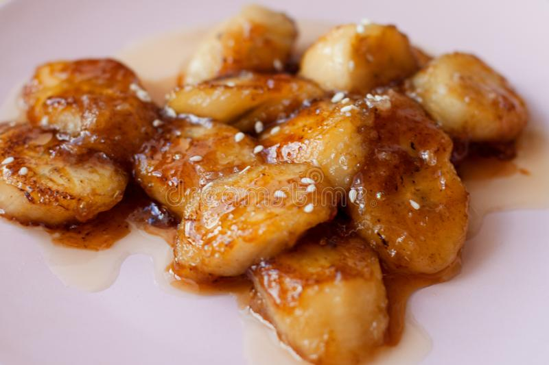 Caramelized bananas with sesame seeds stock image