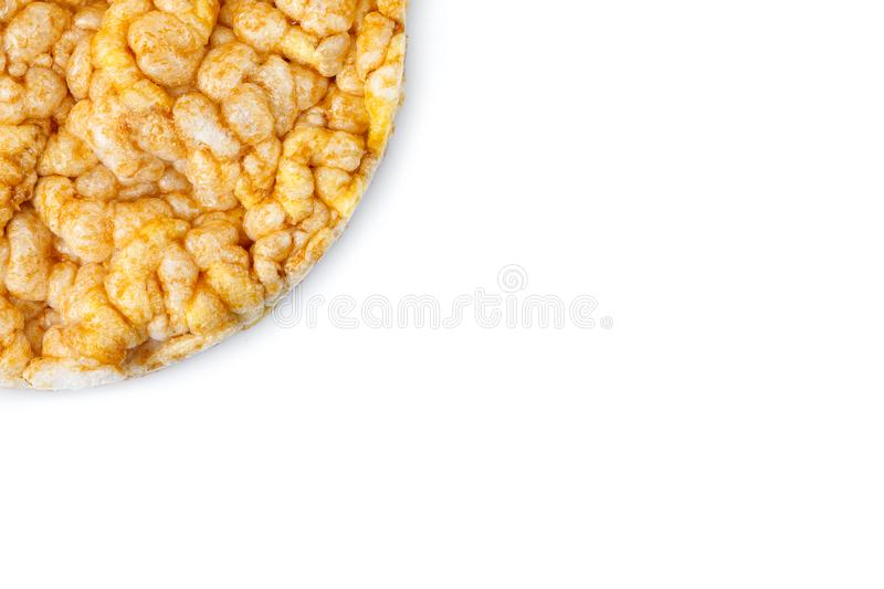 Caramelized corn cakes. Puffed whole grain crispbread isolated on white background. Close-up. Caramelized corn cakes. Puffed whole grain crispbread isolated on stock photography