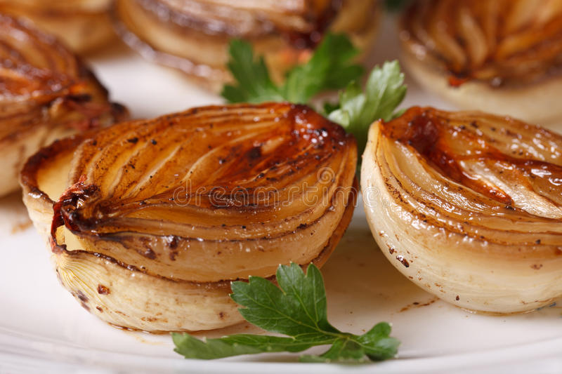 Caramelized onions in balsamic vinegar on plate macro. stock photo