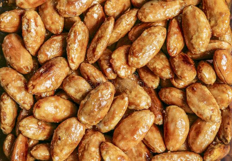 Caramelized peanuts. Caramelized peanuts as background close up royalty free stock photos