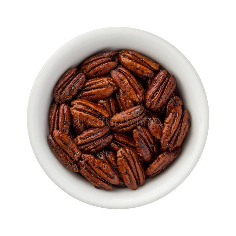 Caramelized Pecans in a ceramic bowl. The image is a cut out, isolated on a white background, with a clipping path. The isolation is on a transparent stock images