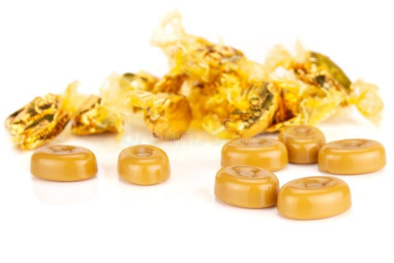 Caramella al burro crema della caramella del caramello isolata su bianco fotografie stock libere da diritti