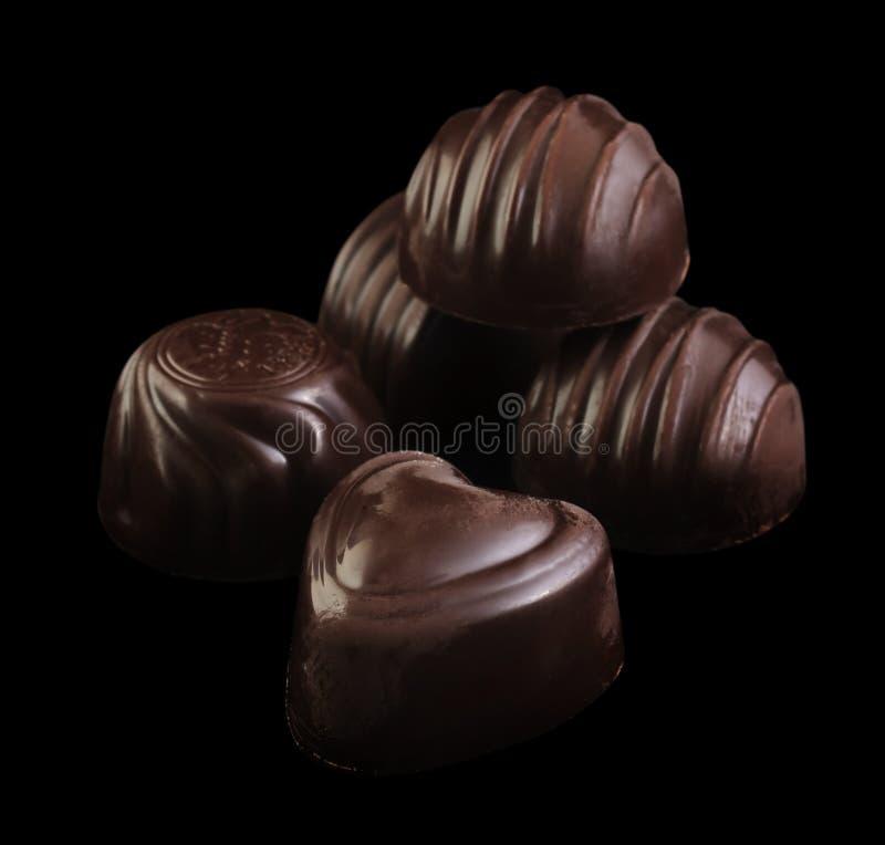 Caramella di cioccolato sul nero fotografia stock libera da diritti