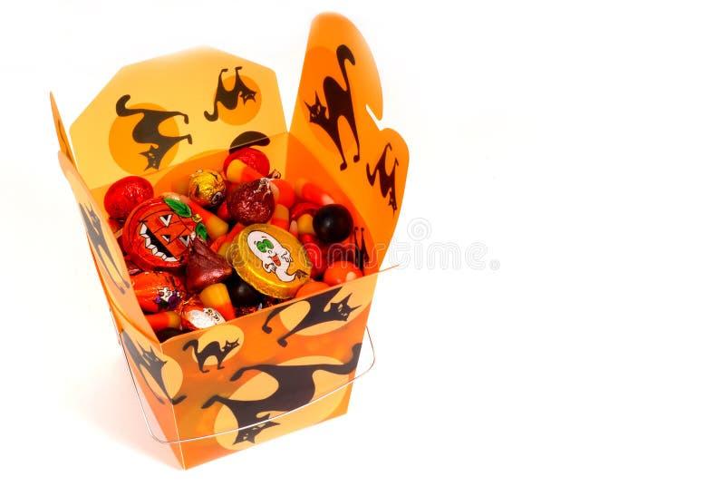 Caramella di Halloween in contenitore cinese arancione immagine stock libera da diritti