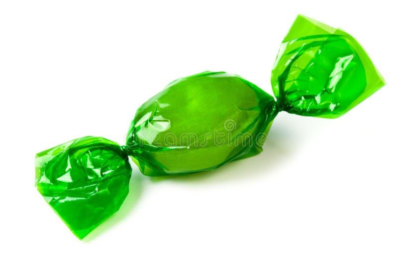 Caramella verde spostata in stagnola fotografia stock libera da diritti