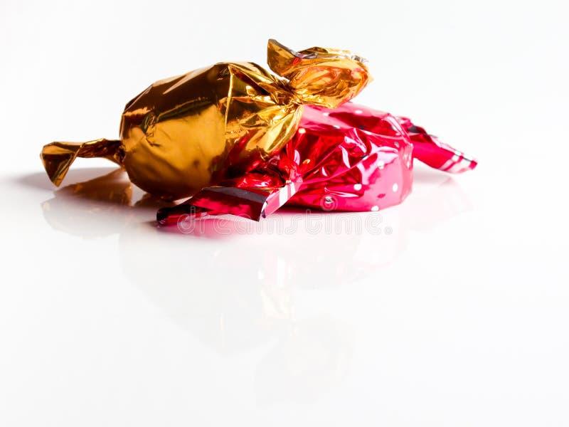 Caramelle a colori involucri fotografia stock