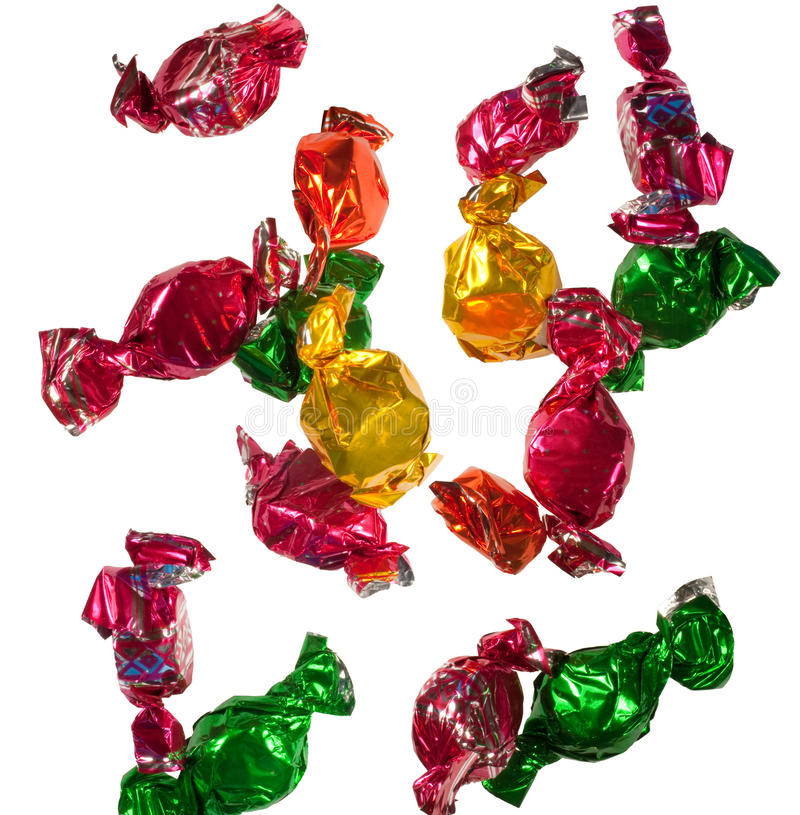 Caramelle di caduta dei dolci fotografia stock