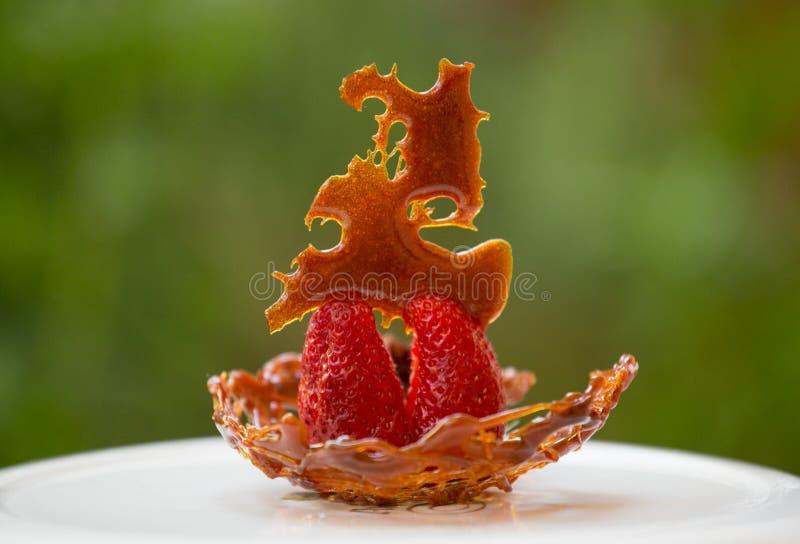 Caramello et fraises fotografie stock