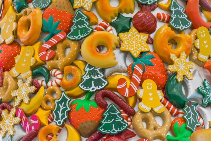 Caramelo de la Navidad, piruleta y frutas coloreadas foto de archivo