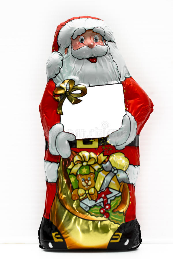 Caramelo envuelto en Papá Noel imagen de archivo libre de regalías