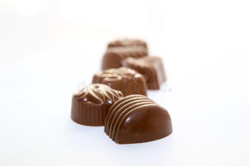 Caramelos de chocolate en línea imágenes de archivo libres de regalías