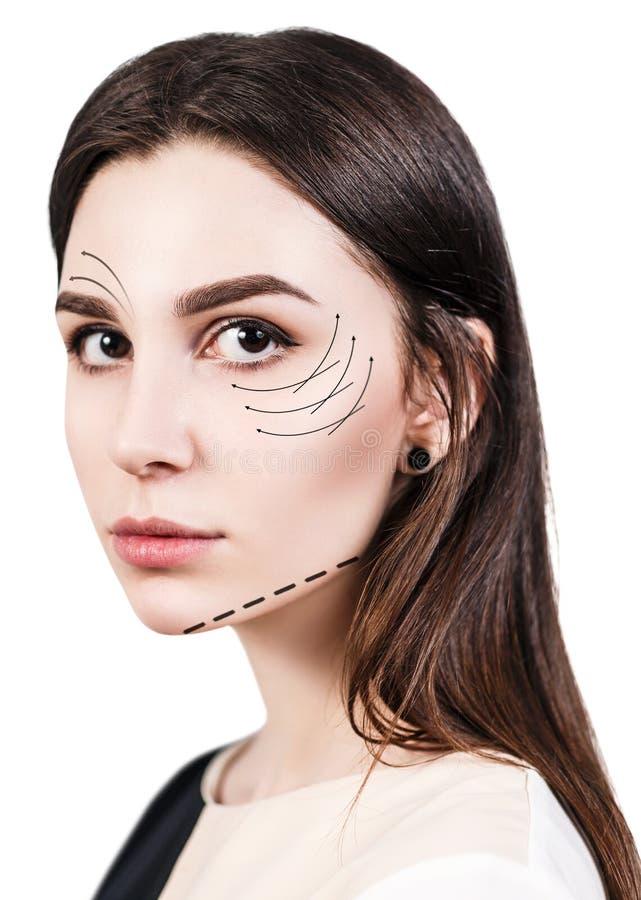 Caras de la mujer joven con las flechas de elevación fotografía de archivo libre de regalías