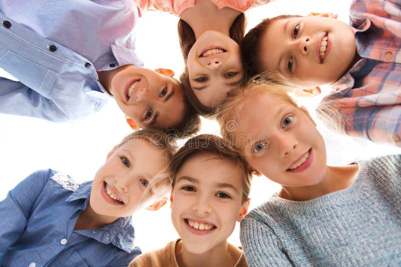 Caras de sorriso felizes das crianças fotografia de stock