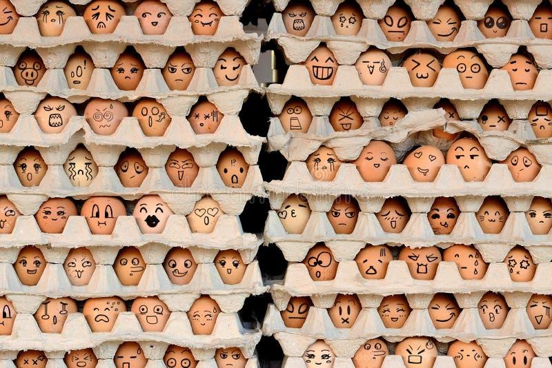 Caras en los huevos imagen de archivo libre de regalías