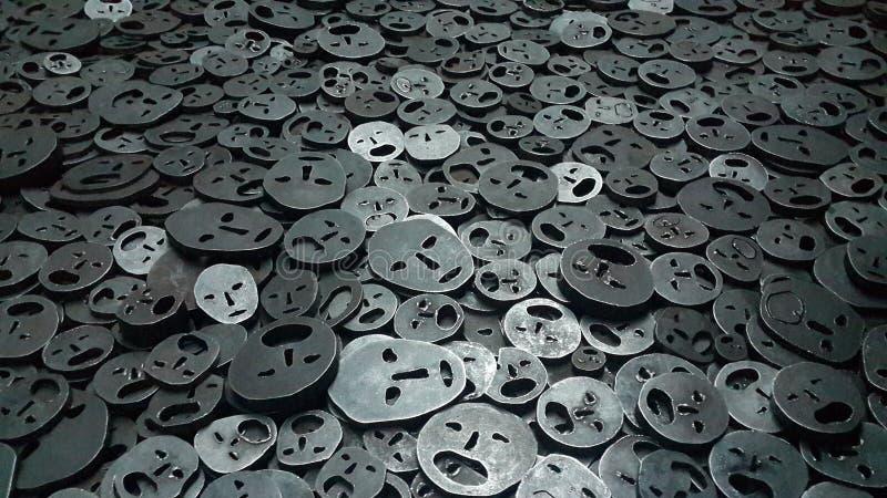 Caras metálicas de la tristeza y del dolor foto de archivo libre de regalías