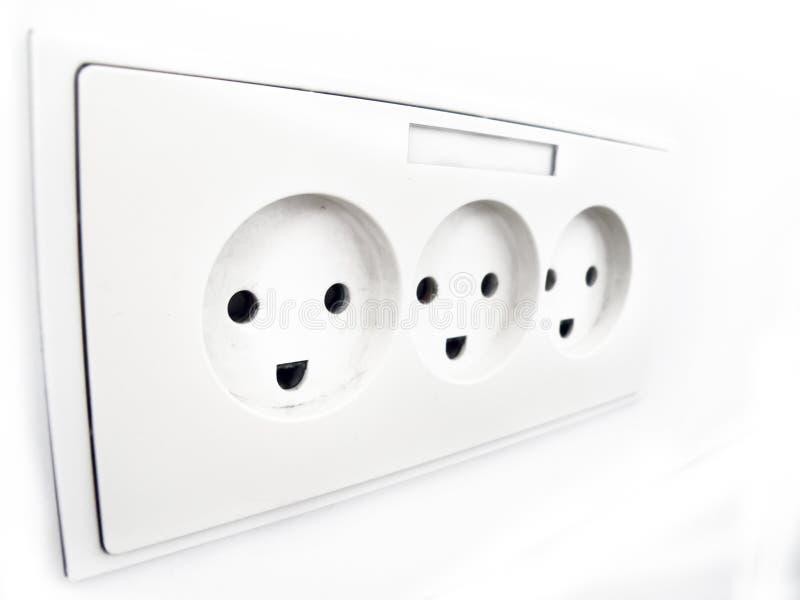 Caras sonrientes de la electricidad fotografía de archivo