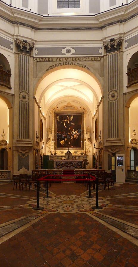 Caravaggio ` s Sette Opere di Misericordia i Naples, Italien arkivfoto