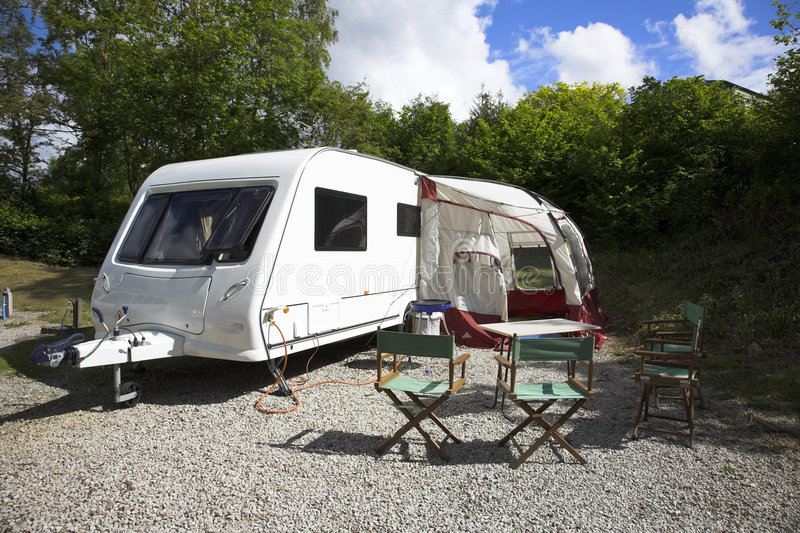 Caravan. And chairs set out for meal royalty free stock images