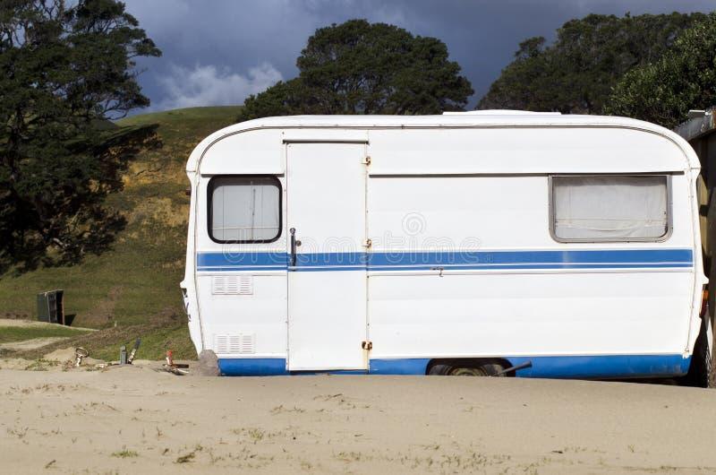 Caravan campsite. An old fashioned trailer caravan in caravans campsite royalty free stock photo