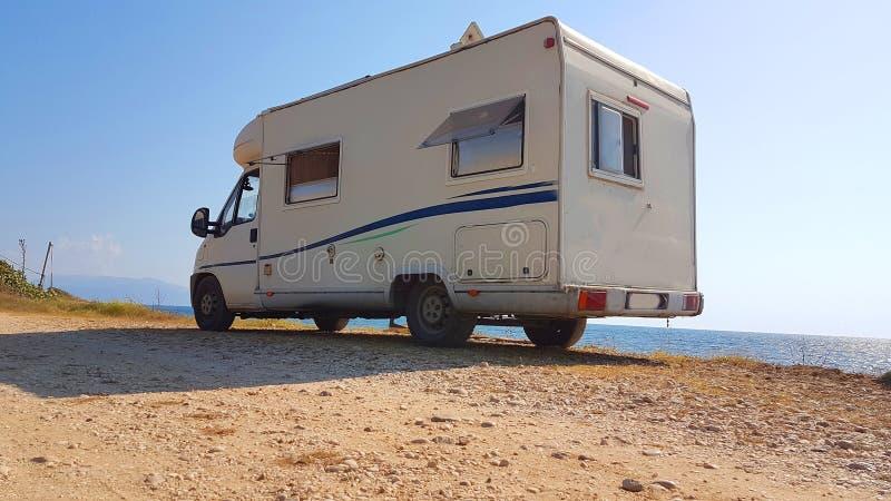Caravan car by the sea holidays in summer stock photos