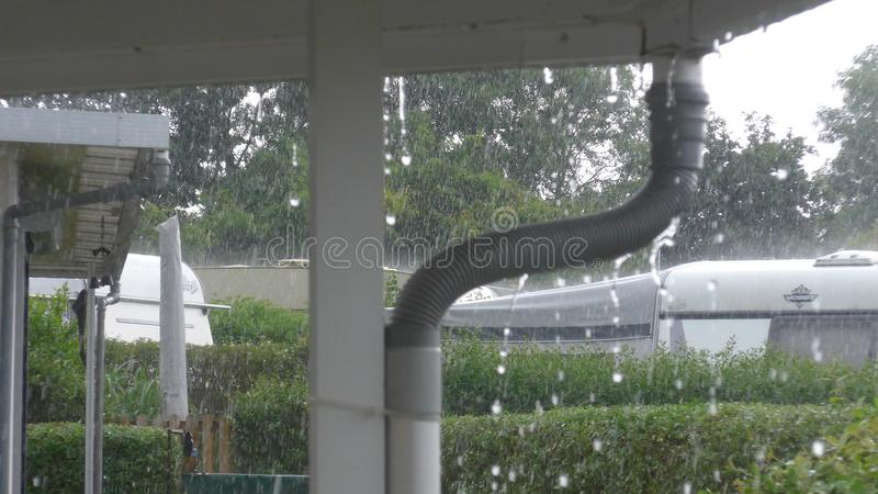 Caravan with a fixed porch on a German campsite on a rainy day.. stock photo