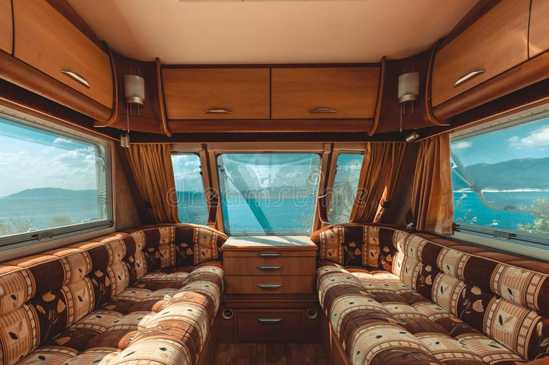 Caravan trailer with sea view, view from the inside, point of vi stock photo