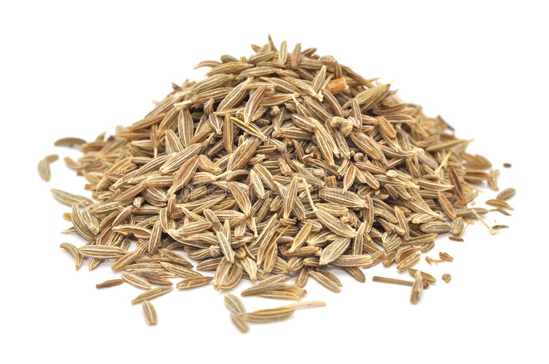 Caraway Seeds. A pile of caraway seeds isolated on a white background stock images