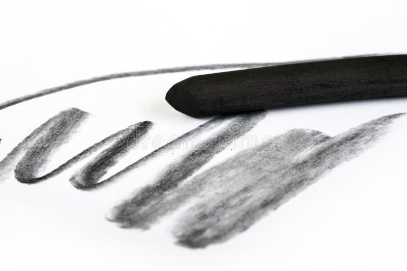 Carbón de leña del negro del ` s del artista con la mancha fotografía de archivo libre de regalías