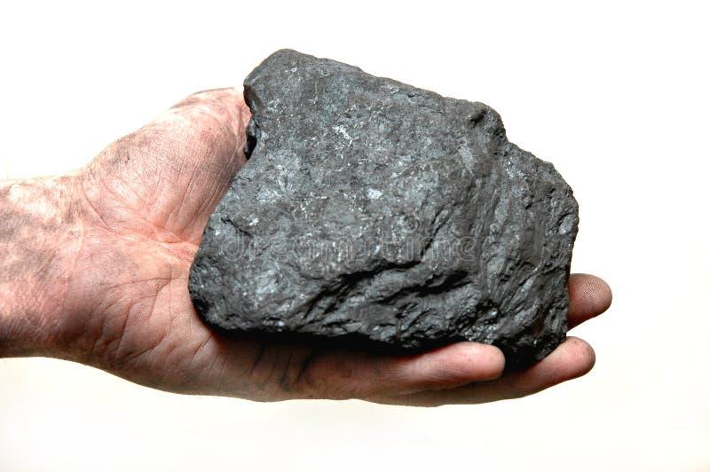 Carbón en la mano del minero fotografía de archivo