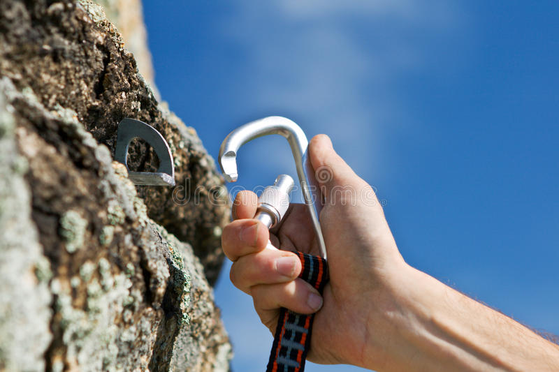 Carbine and hook with rope in stone stock photos