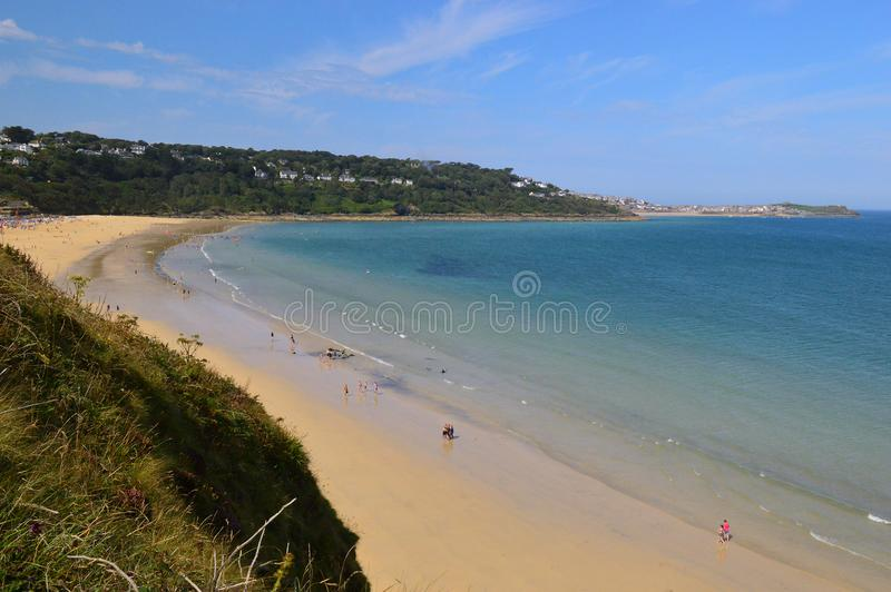 Carbis Bay Beach, St Ives, Cornwall England. Beautiful turquoise and blue sea and golden sand, on a sunny summers day at Carbis Bay Beach, St Ives Cornwall stock images