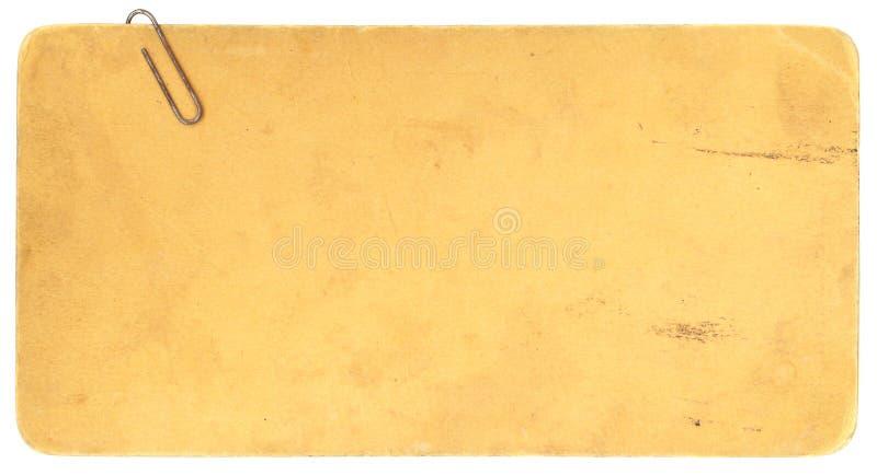 Carboard velho com um Paperclip e um Copyspace oxidados fotos de stock