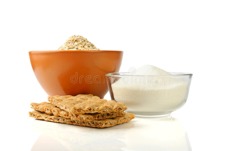 Carbohydrate foods. Oat, sugar and rye crisps: carbohydrate foods in a bowls stock photos