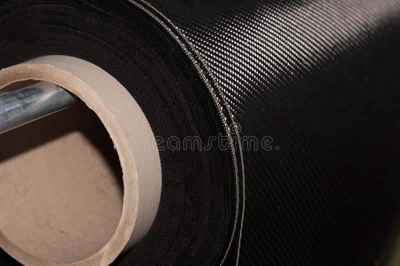 Carbon fiber rolled weave composite material stock photos