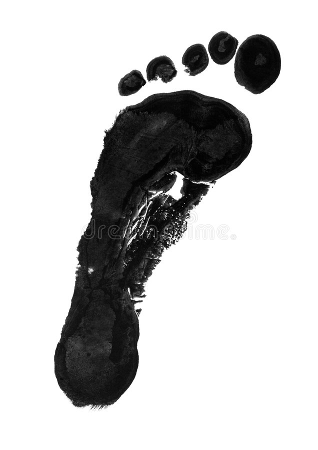 Carbon footprint. Black ink impression of left foot to illustrate a carbon footprint royalty free stock photos