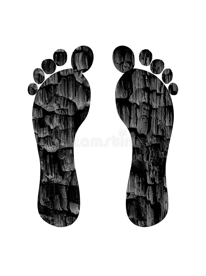 Carbon footprint concept. Two feet with coal texture - carbon footprint concept royalty free stock photos
