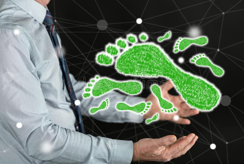 Concept of carbon footprint. Carbon footprint concept above the hands of a man royalty free stock photography