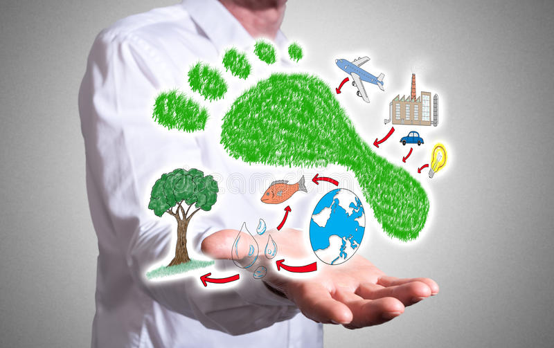 Carbon footprint concept above a human hand. Carbon footprint concept levitating above a human hand royalty free stock images
